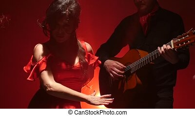 Girl dancing flamenco . Light from behind. Slow motion