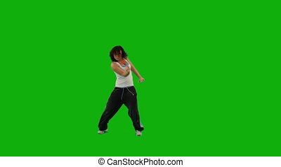 Girl Dancing Hip-Hop. Green Screen - A girl dancing hip-hop...