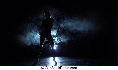 Girl dancing in a beautiful manner, smoke, lights. Slow motion