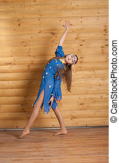 Girl dancing in blue dress