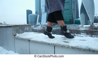 Girl dancing in boots in the snow