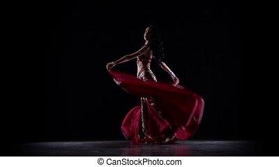 Girl dancing in dress . Black background. Slow motion - Girl...