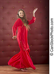girl dancing  in red orient dance costume