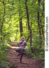 girl dancing in spring forest