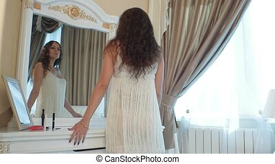 Girl dancing in the bedroom in front of the mirror.