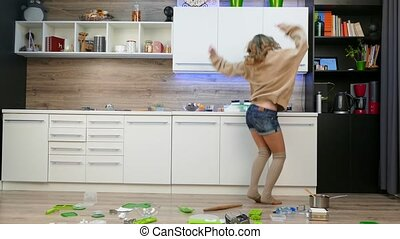 Girl dancing in the kitchen.
