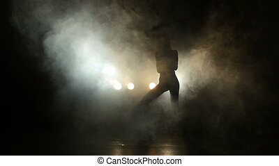 Girl dancing in the mist