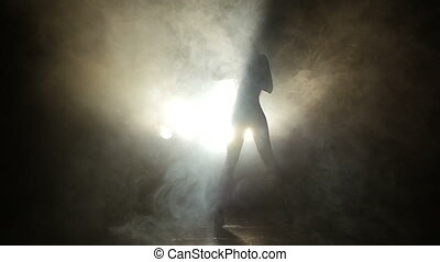 Girl dancing in the studio in the smoke
