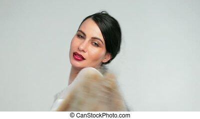 girl dancing in the Studio with fur coat in hand. Glamorous...