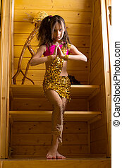 girl dancing indian dance in wooden house