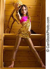 girl dancing indian dance in wooden house