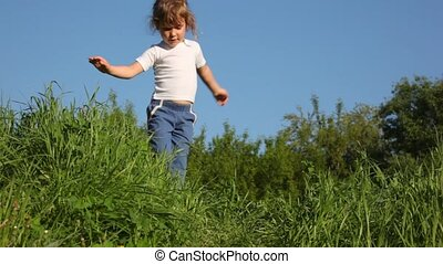 girl dancing on meadow