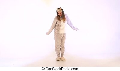 Girl dancing on white background in slow motion
