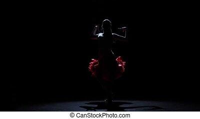 Girl dancing passionate samba dance, silhouette. Slow motion
