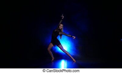 Girl dancing samba. Smoke. Dark background, blue backlight -...