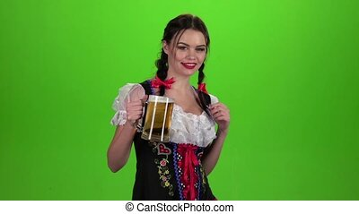 Girl dancing with a glass of beer in his hand and showing thumb up