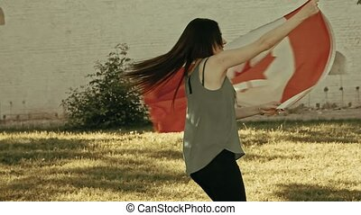 Girl dancing with Canada nation flag