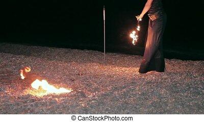 girl dancing with fire fan