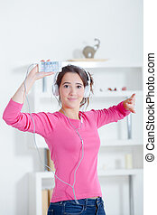 girl dancing with headphones