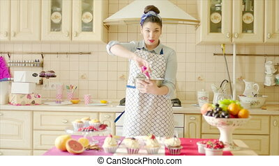 Girl dancing with utility whisk in