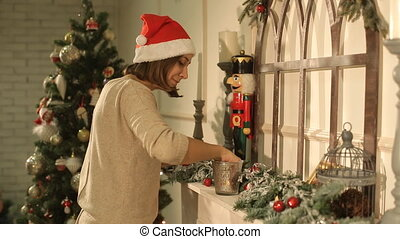 girl decorates a room for Christmas