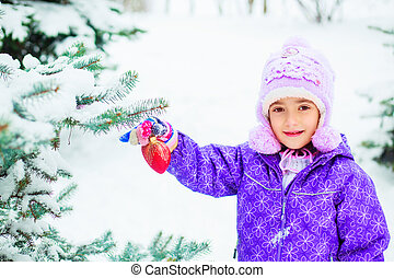 girl decorating a tree