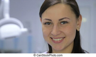 Girl dentist in the office - Doctor in the office of...