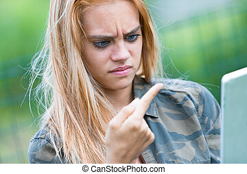 girl disgusted by something on her finger - girl outdoors...