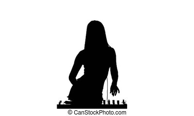 Girl DJ and dancing erotically playing on turntables. White background. Silhouette