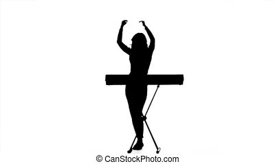 Girl dj playing electronic keyboards. Silhouette. Slow motion