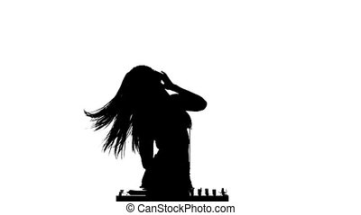 Girl DJ sexy dancing erotically and rotates his head. Slow motion. Silhouette