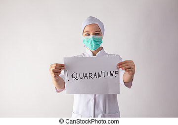 Girl doctor holds a quarantine sign in his hands