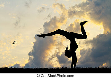 Girl does contortion at sunset