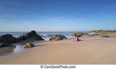 Girl Does Yoga Assana against Ocean Waves Upper View