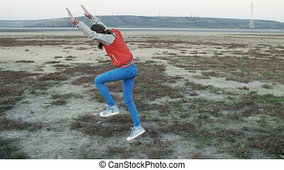 Girl doing a Cartwheel. Happy teenage girl in school uniform