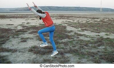 Girl doing a Cartwheel. Happy teenage girl in school uniform