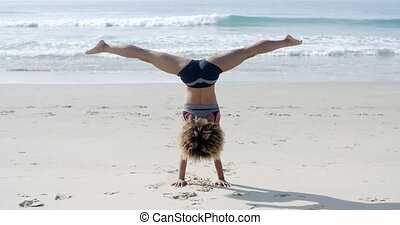 Girl Doing A Handstand On A Beach - Sport young black woman...