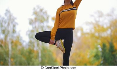Girl doing acrobatic stand. Gymnast on training. Gymnast...