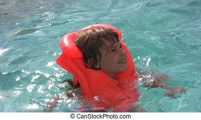 girl doing aqua aerobic in water pool