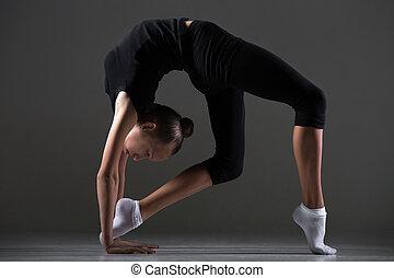 Girl doing backbend exercise