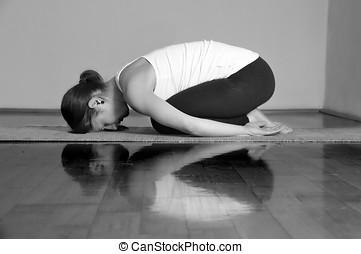 balasana yoga pose slim girl on white background resting