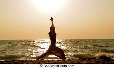 girl doing exercises on the beach
