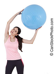 girl doing exercises with fitness ball
