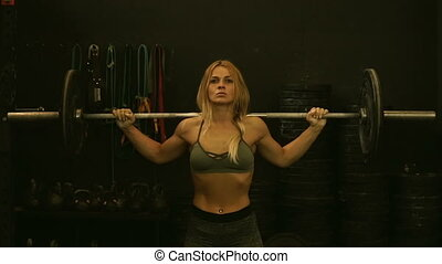 Girl doing exercises with weight