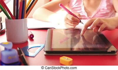 Girl doing homework on tablet pc