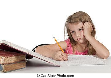 Girl Doing Homework - Pretty little girl doing her school...