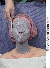 Girl doing lifting with Alginate Peel-Off Powder facial Mask