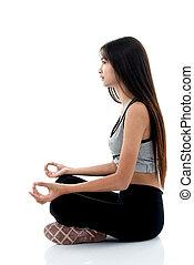 Girl doing meditation on white.