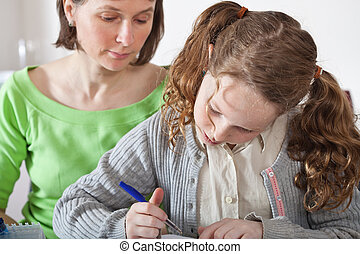 Girl doing prework with her mom - Teenager girl sitting...