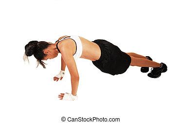 Girl doing push-ups.